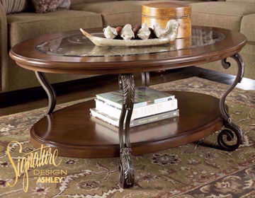 Side View of the Brown Nestor Coffee Table in Room Setting by Ashley Furniture | Home Furniture Plus Mattress