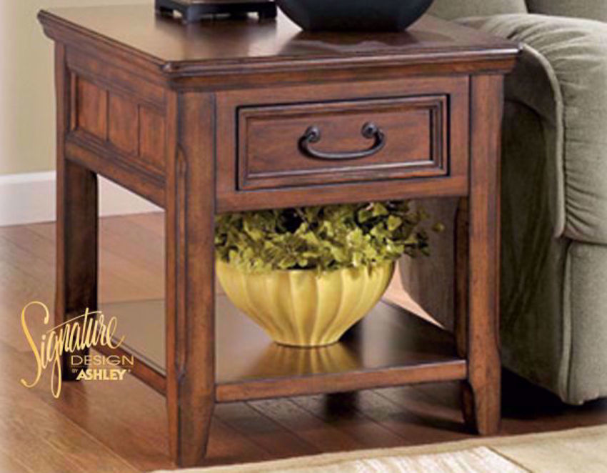 Brown Woodboro Rectangular End Table by Ashley Furniture in a Room Setting | Home Furniture Plus Bedding
