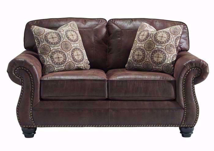 Breville Loveseat by Ashley Furniture Covered in a Dark Brown Leather Like Upholstery with 2 Accent Pillows | Home Furniture Plus Bedding