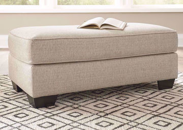 Off White Marciana Ottoman by Ashley Furniture in a Room Setting | Home Furniture Plus Bedding