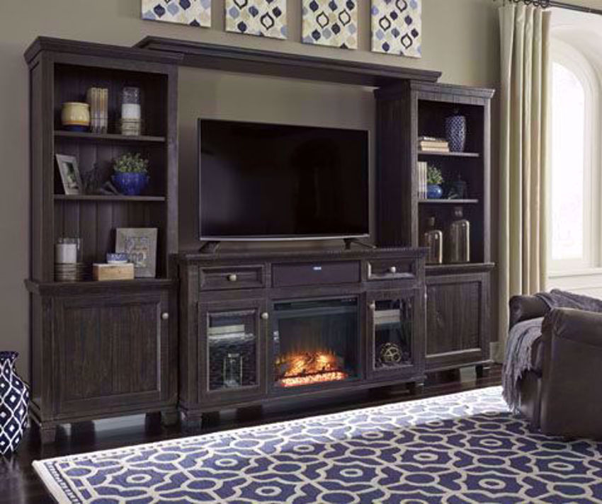 Dark Brown Townser Entertainment Center by Ashley in Room Setting with Fireplace in a Room Setting | Home Furniture Plus Bedding