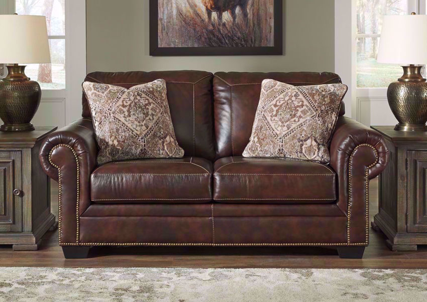 Walnut Brown Roleson Loveseat by Ashley in a Room Setting | Home Furniture Plus Bedding