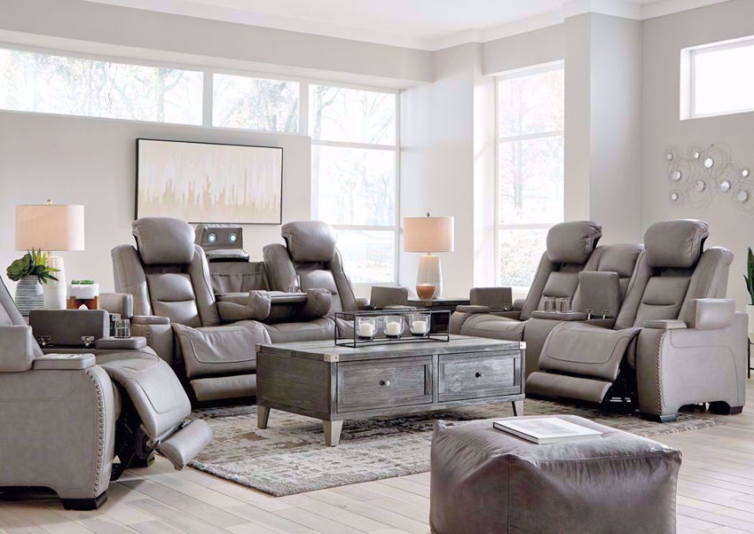 Gray Leather Man-Den Power Reclining Sofa Set by Ashley Furniture Showing a Room Setting | Home Furniture Plus Bedding